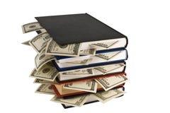 Dólares en los libros Fotos de archivo libres de regalías