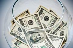 Dólares en una botella Fotografía de archivo