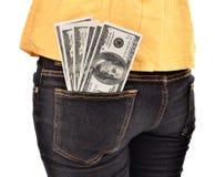 Dólares escondendo da jovem mulher no dinheiro de bolso Imagens de Stock Royalty Free
