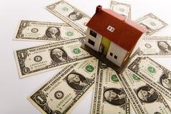 Dólares y casas Imagen de archivo libre de regalías