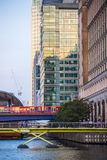 DLR train running through the Canary Wharf business and banking aria, London Stock Photo