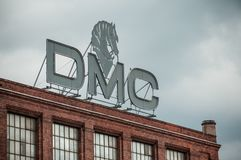 DMC sign  in the roof on old factory with brick wall facade Royalty Free Stock Images