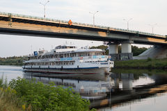 DMITROV AUGUST 7: Ship under the bridge on 7 August 2015 in Dmitrov, Russia Royalty Free Stock Photo