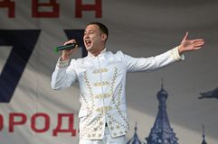 Dmitry Artyomenko sing a song on Day of the Moscow city event. PODOLSK, RUSSIA - SEPTEMBER 9, 2018: Dmitry Artyomenko sing a song on Day of the Moscow city event stock photos