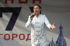 Dmitry Artyomenko sing a song on Day of the Moscow city event. PODOLSK, RUSSIA - SEPTEMBER 9, 2018: Dmitry Artyomenko sing a song on Day of the Moscow city event stock image