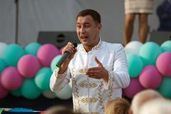 Dmitry Artyomenko sing a song on Day of the Moscow city event. PODOLSK, RUSSIA - SEPTEMBER 9, 2018: Dmitry Artyomenko sing a song on Day of the Moscow city event stock photography