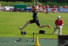 Dmitry Kolosov, triple salto Imagenes de archivo