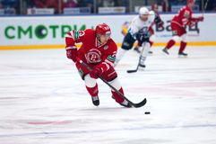 Dmitry Shitikov (23) dribble. MOSCOW - JANUARY 10: Dmitry Shitikov (23) dribble on hockey game Vityaz vs Medvezchak on Russian KHL premier hockey league stock photo