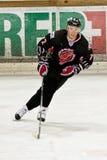 Dmitry Vlasenkov op het ijs Stock Foto