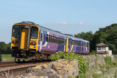Dmu train in Northern livery at Arnside signal box Stock Image