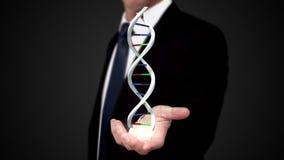 DNA εκμετάλλευσης ατόμων στο χέρι του απόθεμα βίντεο