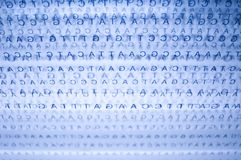 Dna. Chain in a blue background stock photos