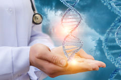 DNA in the hands of a doctor. DNA in the hands of a doctor on a blue background stock images