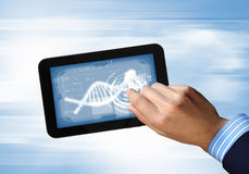Dna strand On The Tablet Screen. DNA helix abstract background on the tablet screen. Illustration Royalty Free Stock Photos