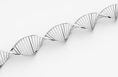 Dna. Metallic dna helix on gray background royalty free stock photography