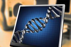 DNA-model op blauwe achtergrond bij monitor Stock Foto