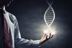 Dna molecule. Close up of male hand holding DNA molecule in palm royalty free stock images