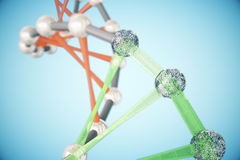 DNA molecules on blue background. Abstract red and green DNA molecules on blue background. 3D Rendering Stock Photo