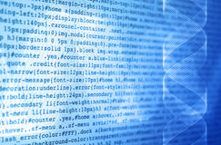 DNA of programming. Programming code on a screen with DNA double helix strands stock photo