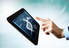 Dna strand On The Tablet Screen. DNA helix abstract background on the tablet screen. Illustration Stock Photo