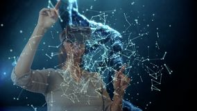 Dna strings with woman using VR headset. Digital composite of DNA strings against businesswoman using VR headset and pointing in the background stock video