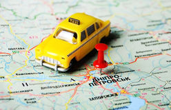 Dnepropetrovsk ,Ukraine Russia taxi map. Close up of Dnepropetrovsk ,Ukraine , map with red pin and a taxi toy royalty free stock photography