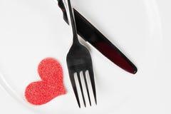 Dîner de Saint Valentin au restaurant sur le fond blanc Images stock