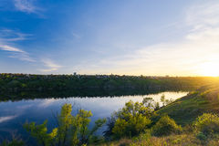 The Dnieper bank. Sunset of Zaporozhye. The Dnieper bank. Sunset through the island of Khortitsa Stock Image