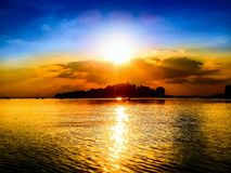 The Dnieper River at sunset. The golden sparkling sunset on the Dnieper River and dark blue sky Royalty Free Stock Photo