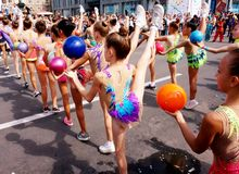 Students of sports clubs on the carnival procession in honor of celebrating the city day. royalty free stock images
