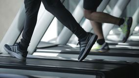 Dnipro March 2017. Young athletic man running on treadmill in sport gym. stock footage