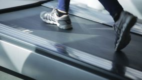 Dnipro March 2017. Young athletic woman running on treadmill in gym. Close-up stock footage