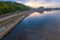 Dnipro river at sunset. Embankment of Dnieper river and Poshtova Square on Podil in historical district of Kyiv, Ukraine. Kyiv, Ukraine - April 28, 2019: Dnipro stock photos