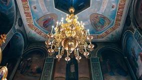 Dnipro, Ukraine - August 06, 2017: Church of St. Nicholas, large. Gold or bronze chandelier in the temple or cathedral, big bronze with handelier in the church Royalty Free Stock Photos