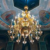 Church of St. Nicholas, large gold or bronze chandelier in the temple or cathedral, big bronze with handelier in the church, ortho. Dnipro, Ukraine - August 06 Stock Photo