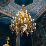 Church of St. Nicholas, large gold or bronze chandelier in the temple or cathedral, big bronze with handelier in the church, ortho. Dnipro, Ukraine - August 06 Stock Images