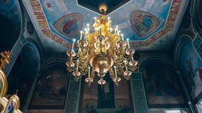 Church of St. Nicholas, large gold or bronze chandelier in the temple or cathedral, big bronze with handelier in the church, ortho. Dnipro, Ukraine - August 06 Stock Photography