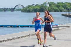 Fourth Alevtina Stetsenko and fifth place Hagar Cohen Kalif competing at the women`s race during Dnipro ETU Triathlon Junior. DNIPRO, UKRAINE - June 03, 2018 royalty free stock photos
