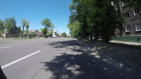 DNIPRO, UKRAINE MAY 29, 2018: Road traffic along Dnipro. Street, timelapse video shooting with an action camera on a bicycle, cyclist rides a bicycle between stock footage