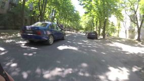 DNIPRO, UKRAINE MAY 29, 2018: Road traffic along Dnipro. Street, timelapse video shooting with an action camera on a bicycle, cyclist rides a bicycle between stock video footage