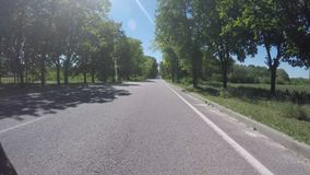 DNIPRO, UKRAINE MAY 29, 2018: Road traffic along Dnipro. Street, timelapse video shooting with an action camera on a bicycle, cyclist rides a bicycle between stock video