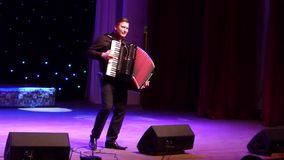 Famous accordionist Vladimir Zuban. DNIPRO, UKRAINE - SEPTEMBER 23, 2017: Famous accordionist Vladimir Zuban performs Ukrainian folk songs at the Philharmonic stock video footage