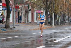 Winner Oleksandra Shafar running on a city street during Ukrainian Championship in the marathon among adults Royalty Free Stock Photos