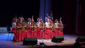 Ukraine is my native land. DNIPRO, UKRAINE - SEPTEMBER 23, 2017: Members of the Bandura ensemble SORCERESS perform Ukrainian folk songs at the Philharmonic stock footage