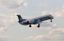 Dniproavia Airlines Embraer ERJ-145EU aircraft on the blue sky background Stock Images