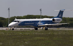 Dniproavia Airlines Embraer ERJ-145LR aircraft preparing for take-off from the runway Royalty Free Stock Photo