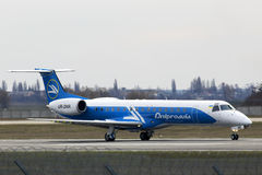 Dniproavia Embraer ERJ-145 aircraft landing on the runway Stock Images