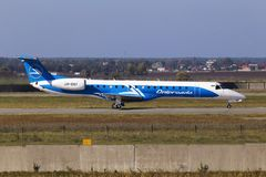 Dniproavia Embraer ERJ-145 aircraft preparing for take-off from the runway Stock Image
