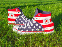 Dnipropetrovsk, Ukraine - August, 21 2016: All Star Converse sneakers on green grass Royalty Free Stock Photo