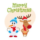 Dnowman in hat and mittens with Christmas reindeer in scarf Stock Image
